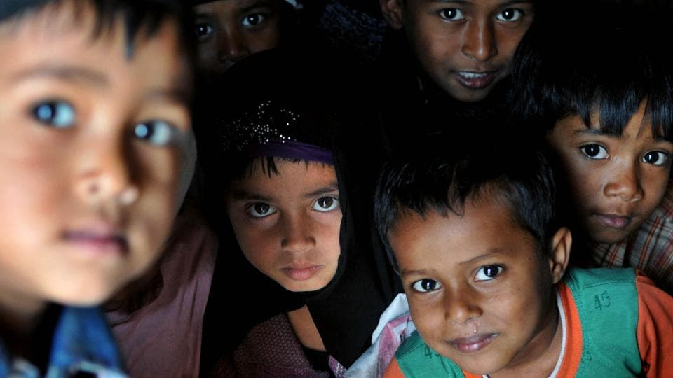 Rohingya Muslim children from Myanmar look on as they play at a refugee camp on the outskirts of Jammu. They have entered into the Jammu and Kashmir state illegally through either Indo-Bangladesh border, Indo-Myanmar border or travelling through the Bay of Bengal. There are about 40,000 Rohingya Muslims living in different parts of the country.  (Nitin Kanotra/HT Photo)