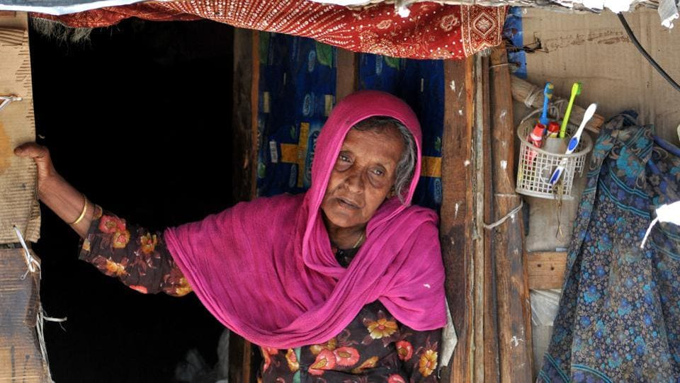 An old Rohingya Muslim woman stands at the entrance of her temporary shed at a refugee camp. Bathindi Ka Plot is home to the highest number of Rohingya migrants — 686 in all. (Nitin Kanotra/HT Photo)