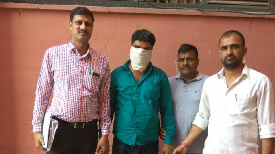 Delhi Police arrested the accused, Rinku (in green shirt) on Thursday.