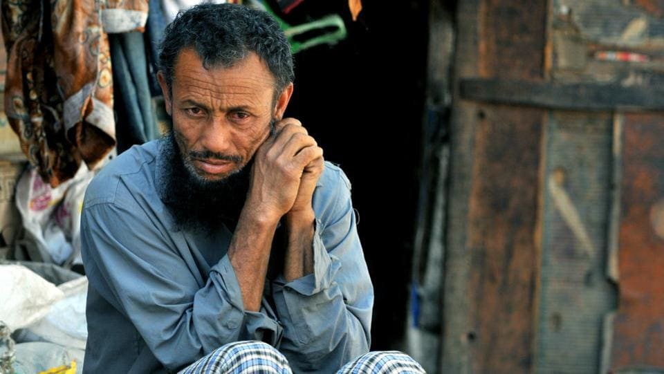 A Rohingya Muslim sitting outside his temporary shed at a refugee camp. Pro-Jammu outfits see their settlement as a sinister design to alter the demography of the Hindu-dominated region.  (Nitin Kanotra/HT Photo)