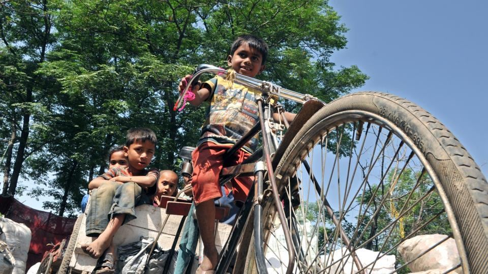 Rohingya Muslim children playing on a cart at a refugee camp on the outskirts of Jammu. Security forces see the Rohingya population as a potential threat in the militancy-hit state close to a hostile neighbour.  (Nitin Kanotra/HT Photo)