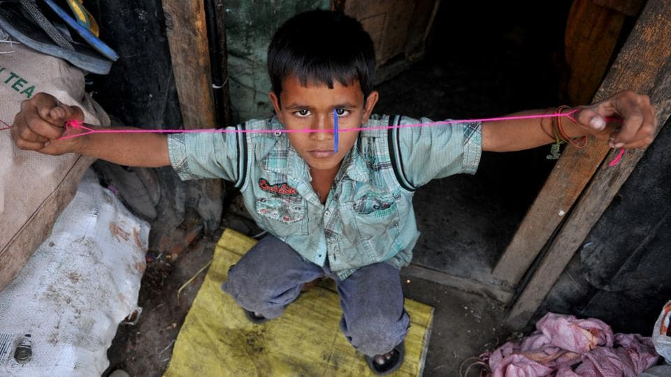 A Rohingya Muslim child playing at a refugee camp.  Union home minister Rajnath Singh has sought a report from the state government over the influx of the illegal immigrants from Myanmar and Bangladesh to Jammu. (Nitin Kanotra/HT Photo)