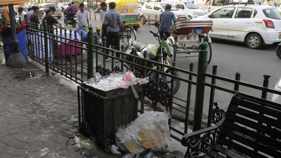 Littered pavement in Hazratganj