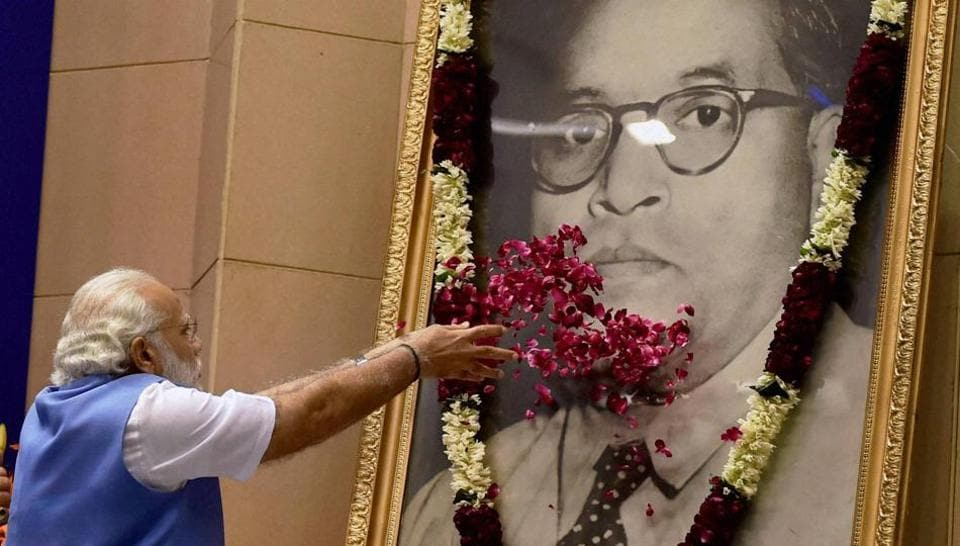 Prime Minister Narendra Modi is seen paying floral tribute before laying foundation stone for Dr. BR. Ambedkar National memorial in New Delhi last year.
