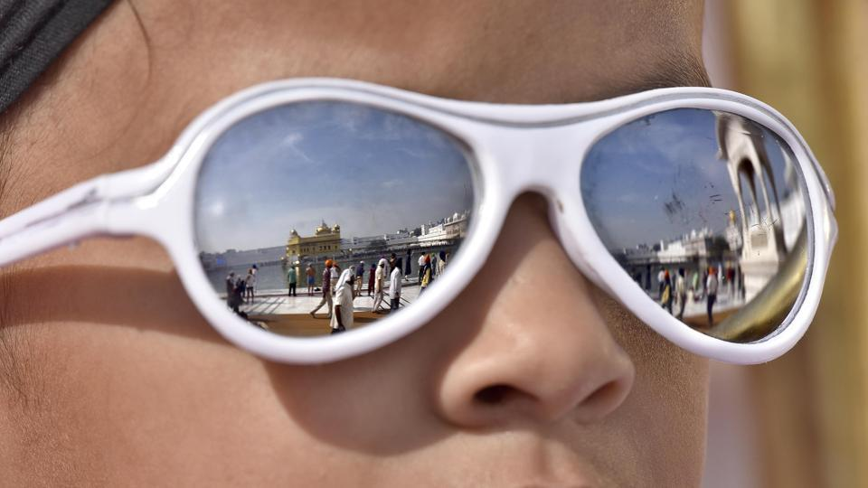 A view of Golden temple displayed on the sunglasses of a devotee at Golden Temple, Amritsar. (Gurpreet Singh/ HT Photo)
