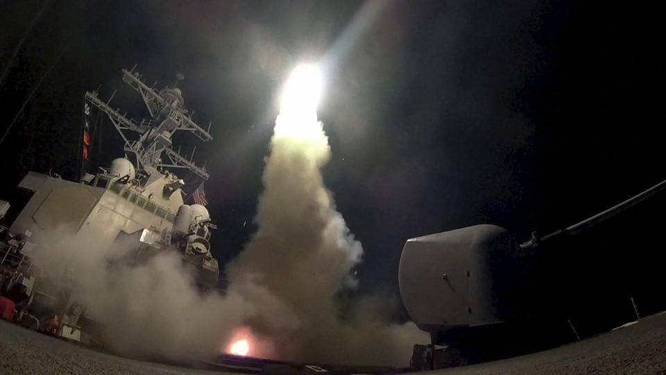 The guided-missile destroyer USS Porter (DDG 78) launches a tomahawk land attack missile in the Mediterranean Sea on April 7.