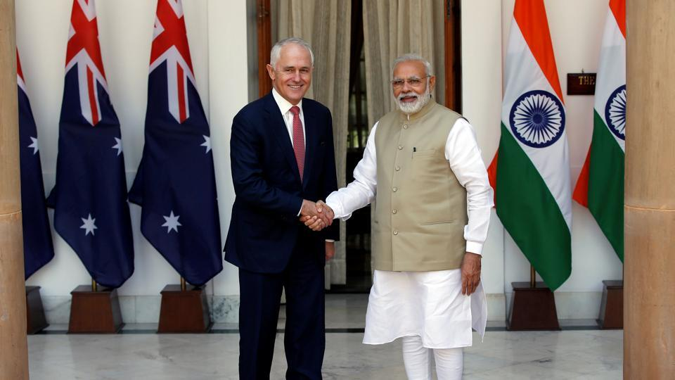 Australia's Prime Minister Malcolm Turnbull (L) shakes hands with his Indian counterpart Narendra Modi during a photo opportunity ahead of their meeting at Hyderabad House in New Delhi on April 10.