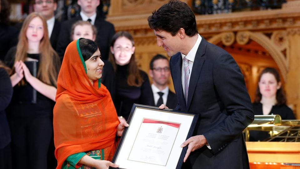 Canada's Prime Minister Justin Trudeau (R) presents Pakistani Nobel Peace Prize laureate Malala Yousafzai with honorary Canadian citizenship during a ceremony in the Library of Parliament on Parliament Hill in Ottawa, Ontario, Canada, April 12, 2017.