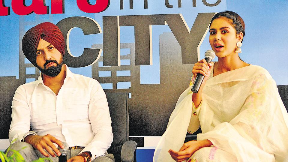 Actors Gippy Grewal and Sonam Bajwa at the HT office in SAS Nagar on Thursday, the eve of their latest release 'Manjey Bistrey'. (Keshav Singh/HT)