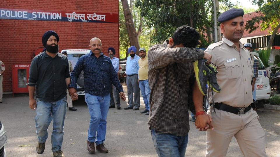 Students for Society (SFS) leader Amritpal Singh (left) and others being taken fromSector-11 police station to court on Wednesday. Singh contested PU student council elections in 2016.