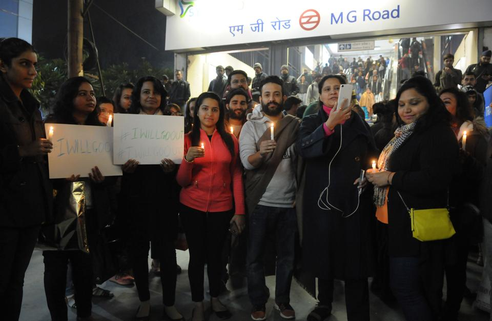Residents take out a candle light march near MG Road metro station to demand necessary measures to ensure women's safety in the city.