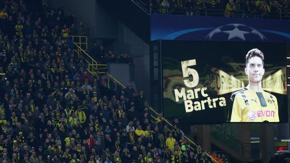 A message is displayed on the giant scoreboard in support of Borussia Dortmund's Marc Bartra just before the UEFAChampions League quarterfinal leg 1 match against AS Monaco at Signal Iduna Park, Dortmund, on Wednesday. Bartra was injured after the Dortmund team bus was hit by explosions ahead of their match vs Monaco on Tuesday night.