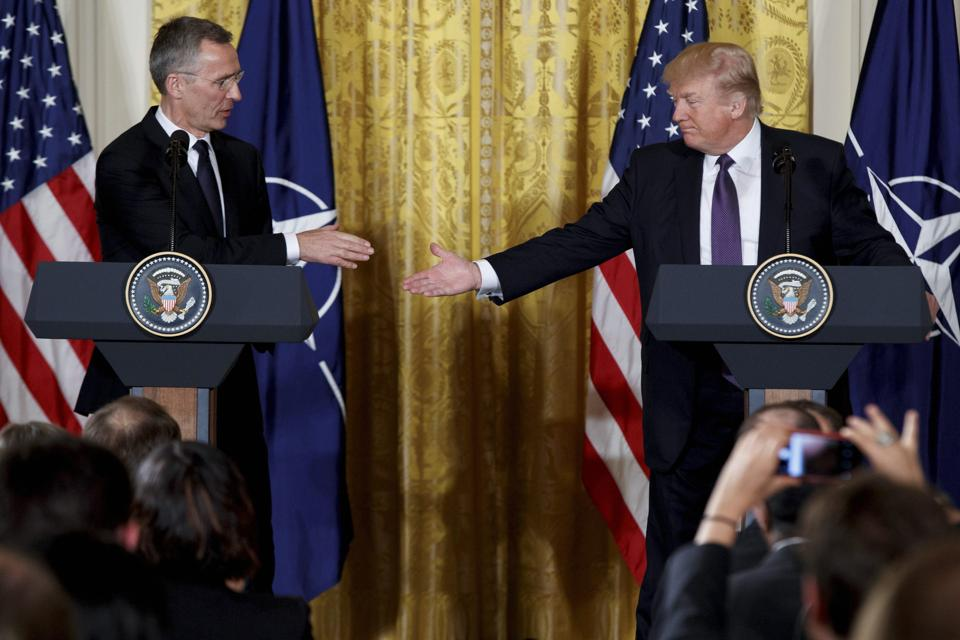 Trump shakes hands with Nato secretary general Jens Stoltenberg at the White House on Wednesday.