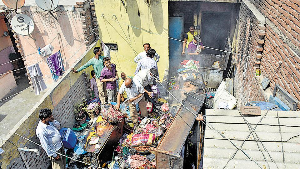 The fire department had to rope in two tenders to douse the fire in the houses located in a narrow bylane.