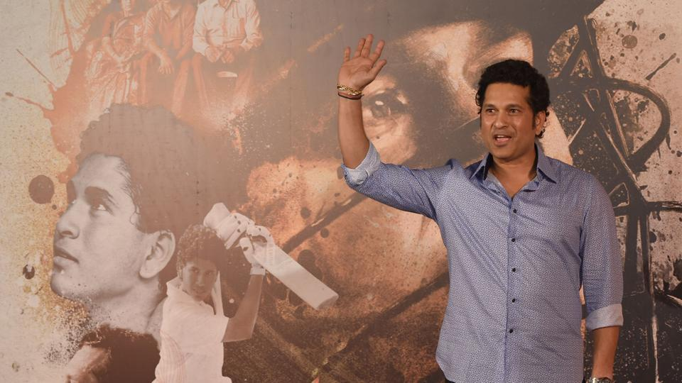 Sachin Tendulkar gestures during the launch of the trailer of the upcoming film on his life