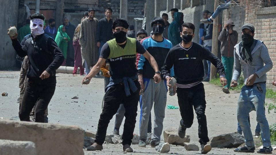 Protestors clash with security forces near a polling station in Srinagar on April 9. Eight civilians were killed in the clashes .