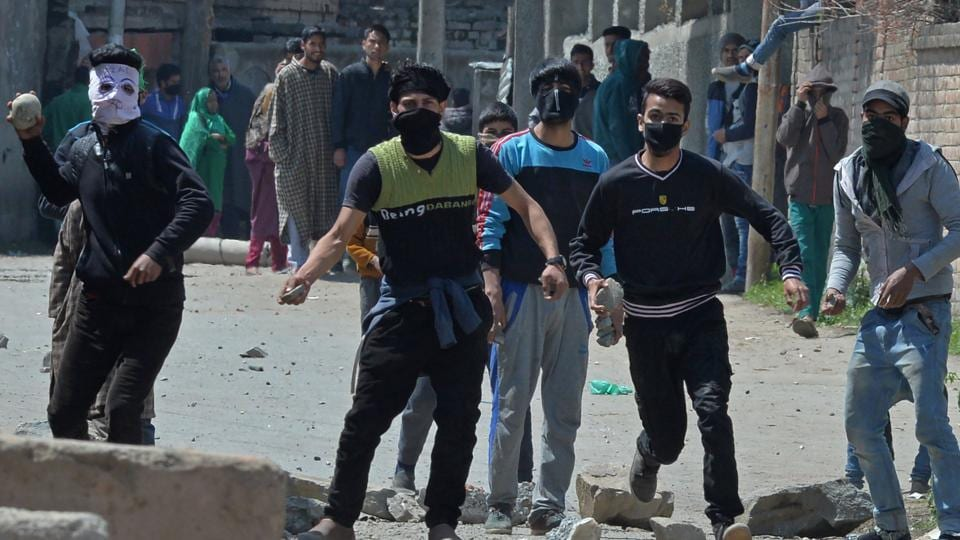 Kashmiri protestors clash with security forces near a polling station in Srinagar on April 9.