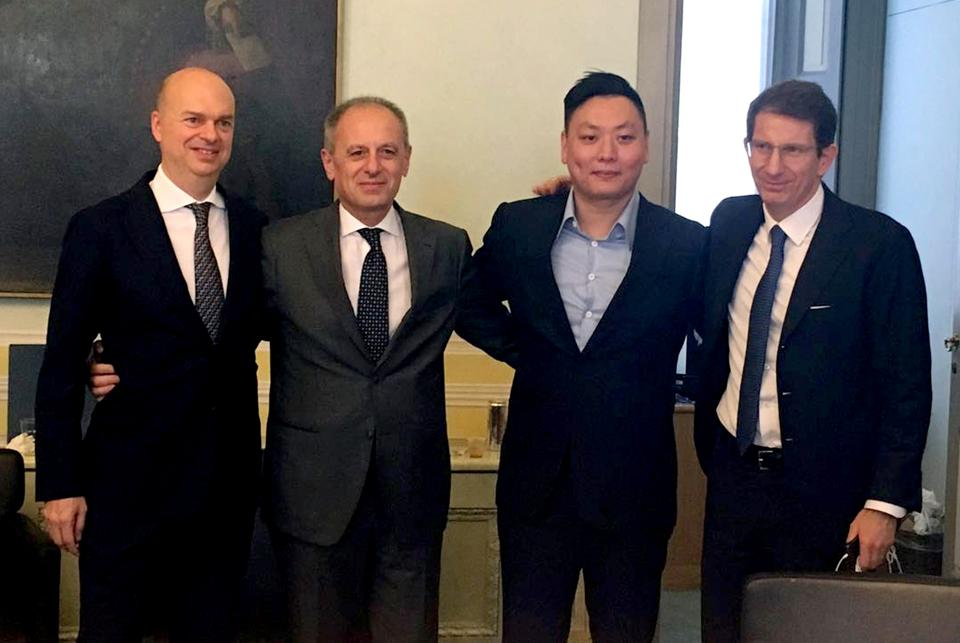 (From left) AC Milan designated CEO Marco Fassone, Fininvest CEO Danilo Pellegrino, David Han Li, and head of Fininvest's business development, Alessandro Franzosi, pose following the transfer of ownership of AC Milan.