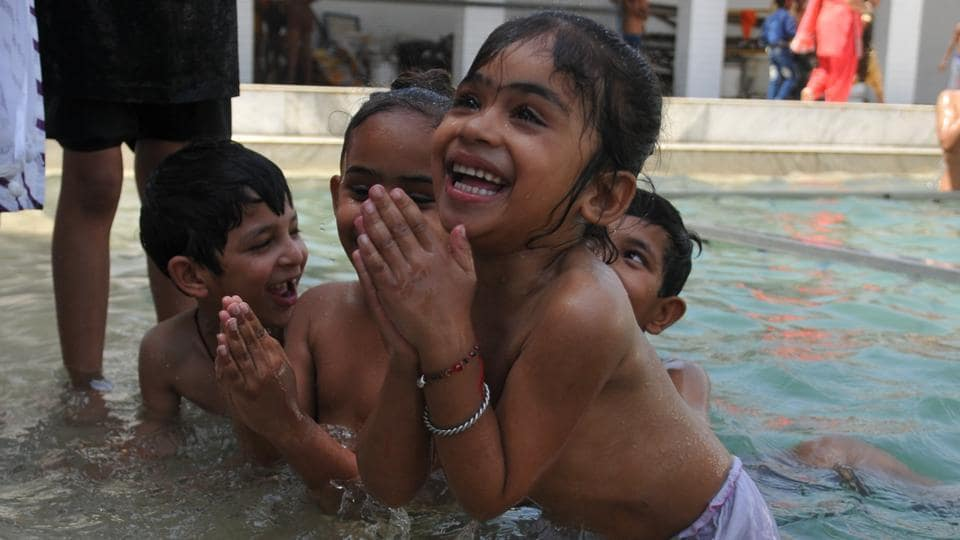 Children taking holy dip in sarovar (water tank) at gurdwara Shaheed Baba Nihal Singh in village Talhan on the out skirts of Jalandhar. (Pradeep Pandit/HT Photo)