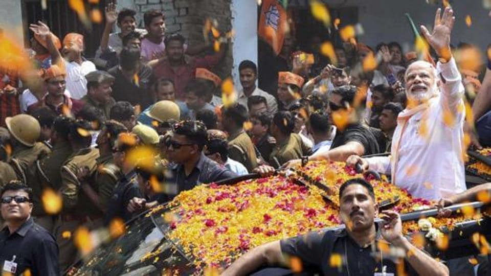 Prime minister Narendra Modi during a road show in Varanasi on March 4, 2017. BJP registered a comprehensive victory in the UPassembly elections.