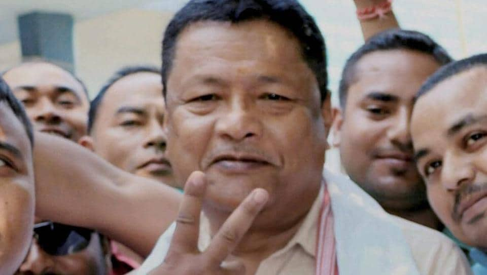 BJP candidate Ranoj Pegu showing victory sign after winning bypoll to assembly seat in Dhemaji, Assam on Thursday.