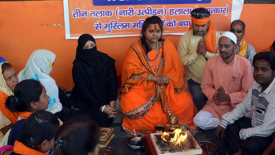 Two Muslim women participating in a hawan organised by All India Hindu Mahasabha.
