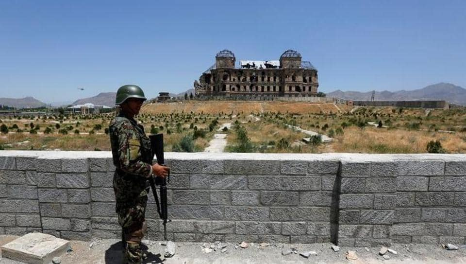 An Afghan National Army (ANA) soldier stands guard after the inauguration of the reconstruction project to restore the ruins of historic Darul Aman palace, in Kabul, Afghanistan.