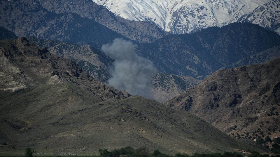 Smoke rises after an air strike on Islamic State (IS) militants positions during an ongoing operation against the group in the Achin district of Afghanistan's Nangarhar province, a day after the US military struck the district with its largest non-nuclear bomb.