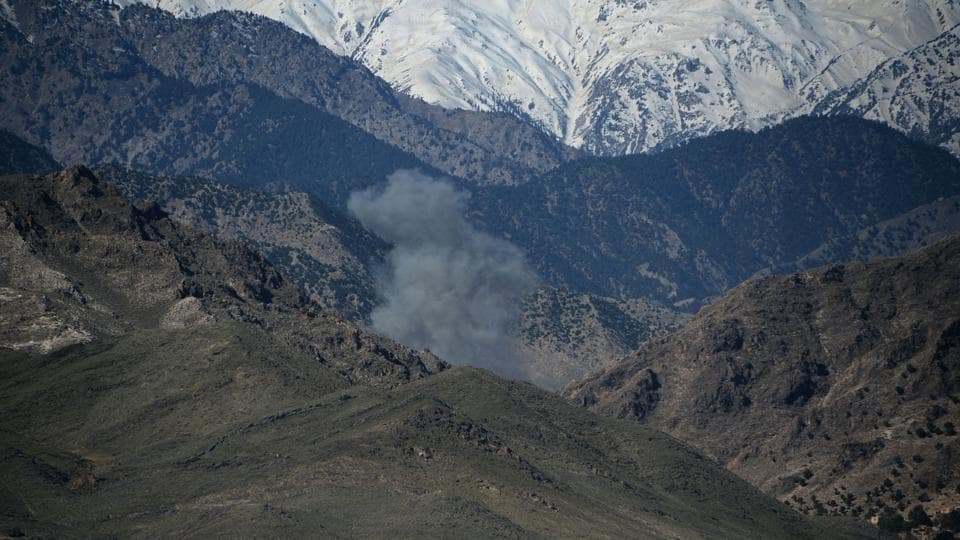 Smoke rises after an air strike on Islamic State (IS) militants positions during an ongoing operation against the group in the Achin district of Afghanistan's Nangarhar province on April 14, 2017, a day after the US military struck the district with its largest non-nuclear bomb.
