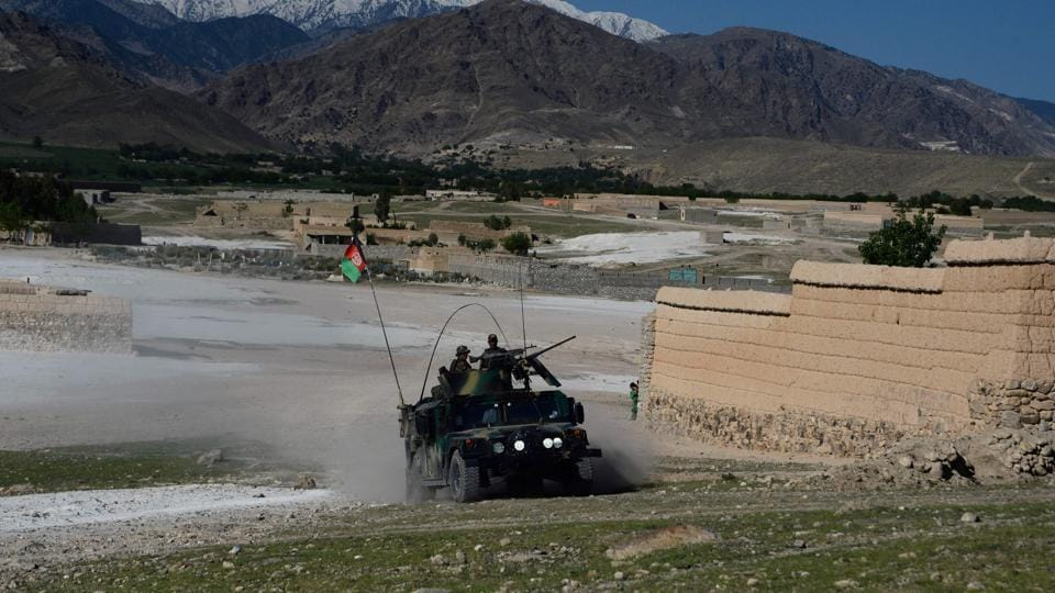 Afghan security forces take part in an ongoing operation against Islamic State (IS) militants in the Achin district of Afghanistan's Nangarhar province on April 14, 2017, a day after the US military struck the district with its largest non-nuclear bomb.