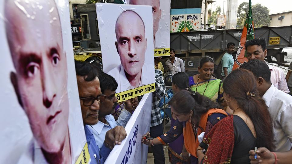 BJPworkers on a signature drive to support of Kulbhushan Jadhav in Mumbai.