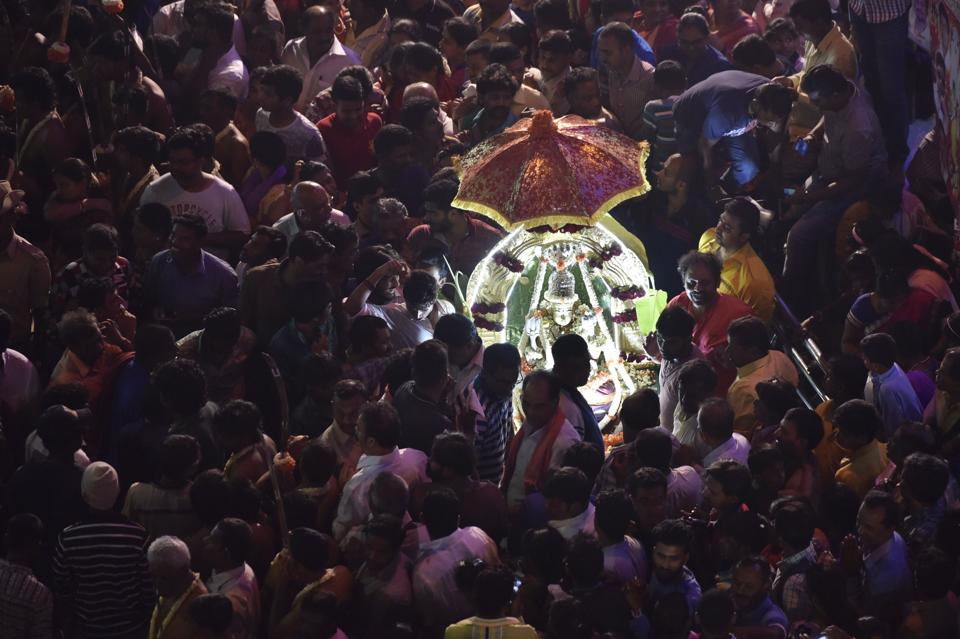 Devotees from the Thigala community performing rituals on the occasion of Karaga at Dharmaraya Swamy Temple in Bengaluru. The story of the 800 year old Karaga festival is also rooted in the Mahabharata with Draupadi being the community deity of the Vanihikula Kshatriyas. The Karaga is an annual celebration of her as the ideal woman and of woman-power (Mother Goddess). (Arijit Sen/HT Photo)