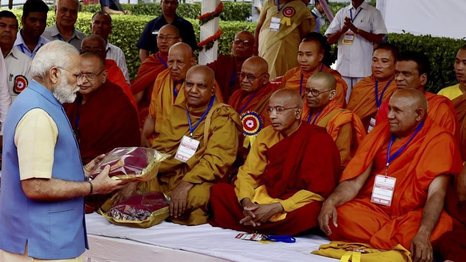 Prime Minister Narendra Modi presents gifts to Buddhists monks at Bhimrao Ambedkar's 126th birth anniversary celebrations at the Parliament House in New Delhi on Friday.