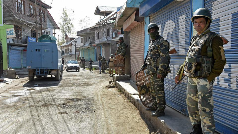 CRPF personnel maintain vigil during repolling in Srinagar Lok Sabha constituency in Budgam district of Kashmir on Thursday.
