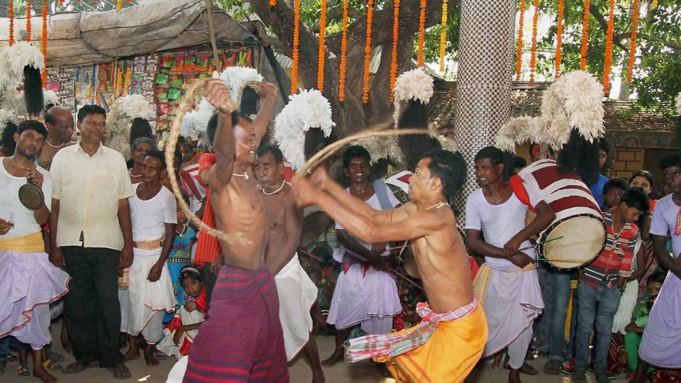 Worshippers, who believe they are blessed and protected by the Lord as they perform a dance, walk on hot embers and pierce their body with iron rods, known as a 'trishul', to show their devotion. (PTI)