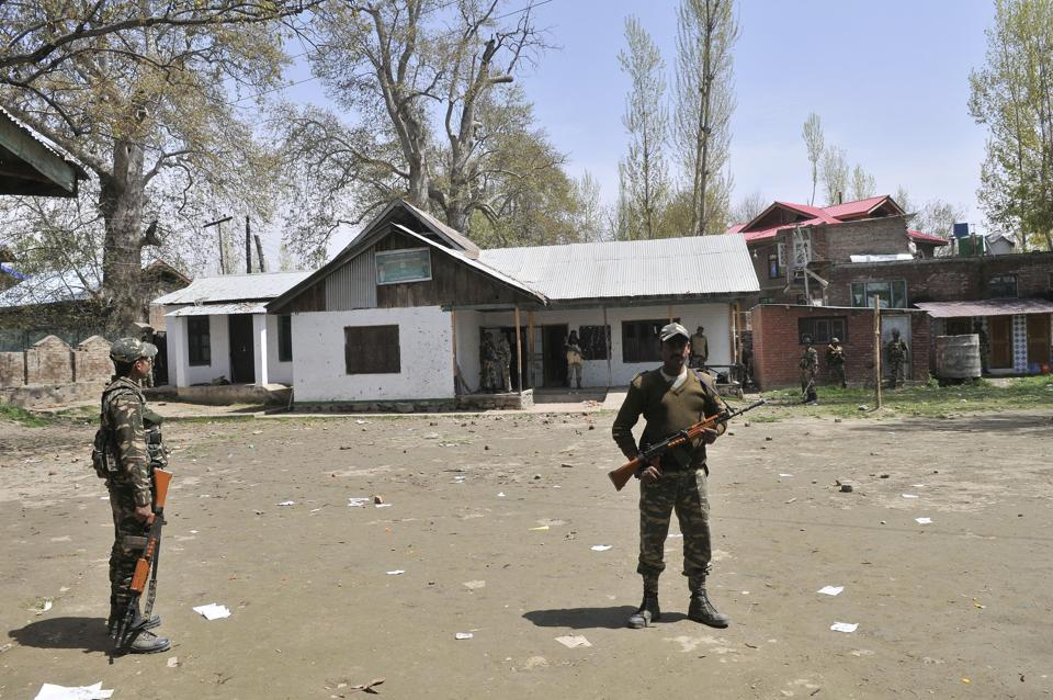 Paramilitary soldiers outside a polling station in Srinagar Lok Sabha constituency where a bypoll on April 9 witnessed unprecedented violence.