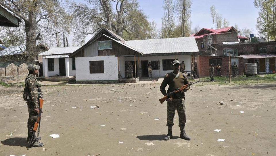 Paramilitary soldiers stand guard inside a polling station in Chadoora, in Budgam district some 25 kms from Srinagar.