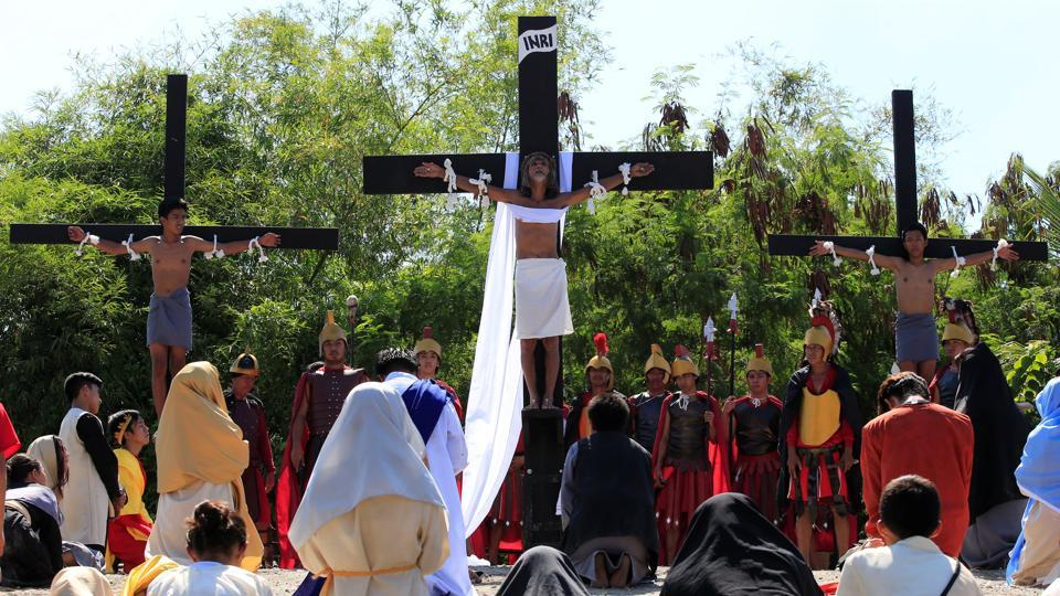 Willy Salvador (C), 60, who is portraying Jesus Christ, is nailed on a wooden cross during a Good Friday crucifixion re-enactment in San Juan village, Pampanga province, north of Manila, Philippines. Protestants, on the other hand, do not have food restrictions on Good Friday but many follow the 'no meat' rule like the Catholics. (Romeo Ranoco/REUTERS)