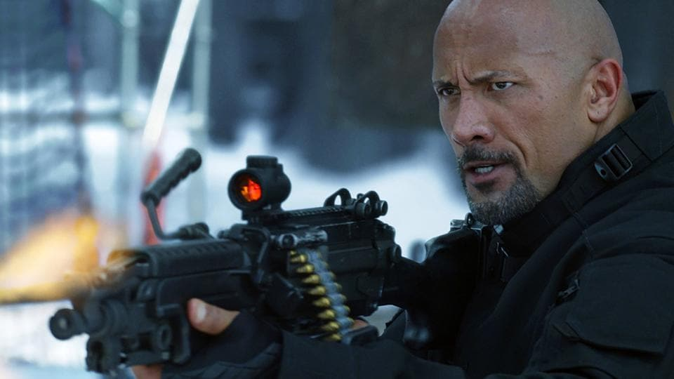 This image released by Universal Pictures shows Dwayne Johnson in The Fate of the Furious.