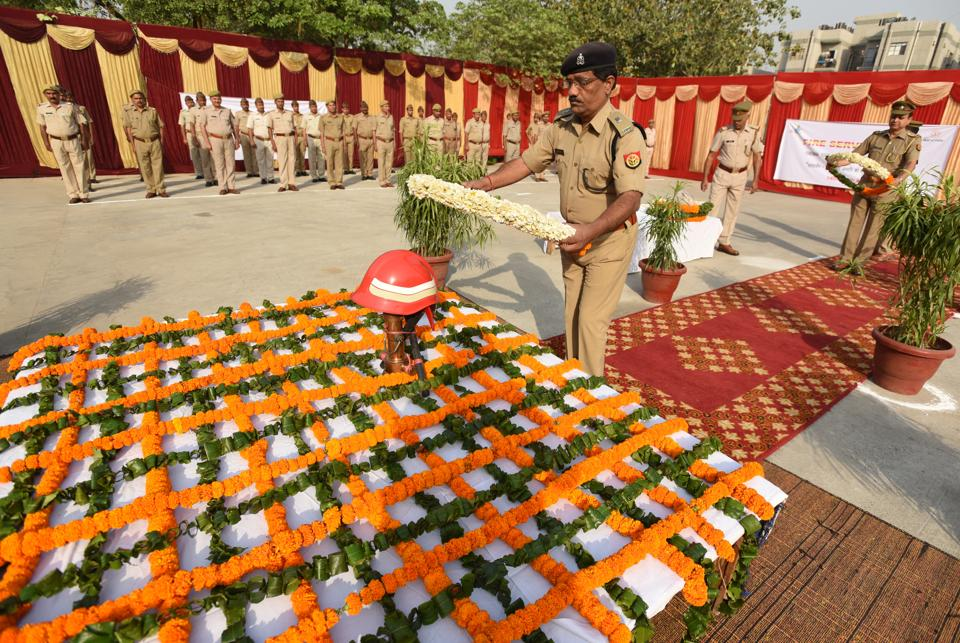Dinesh Yadav ,SP (city) Noida, pays homage to fallen firemen on Fire Service Remembrance Day in Noida, India on Friday.