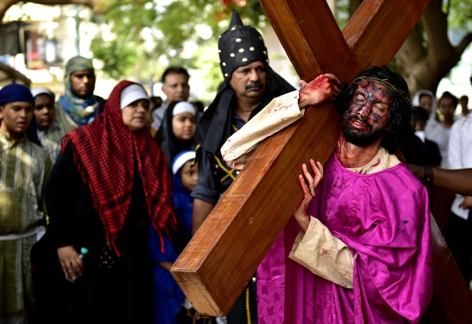 An artist enacts the crucifixion of Jesus on the occasion of Good Friday at Our Lady Lourdes Church at Cambridge Layout in Bengaluru, India. (Arijit Sen/HT Photo)