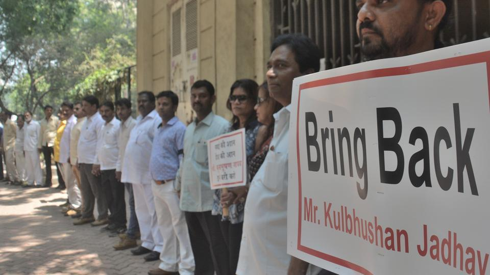 Residents of Powai make a human chain demanding release of  Kulbhushan Jadhav, who has been given death sentence, in Mumbai on Thursday.