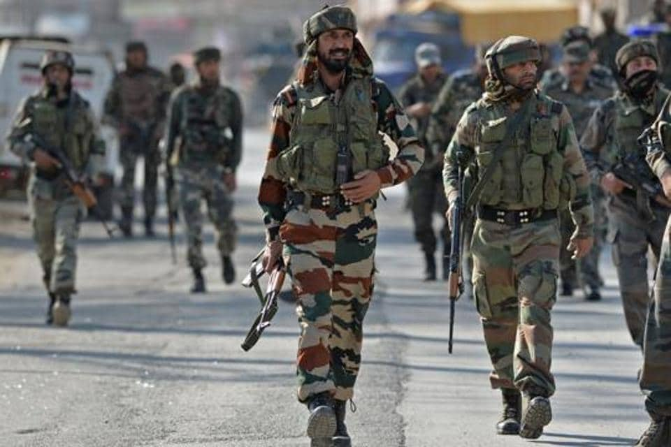 Army soldiers arrive at the scene of an attack on a  Central Reserve Police Force (CRPF) convoy at Pantha chowk on the outskirts of Srinagar on April 3, 2017.