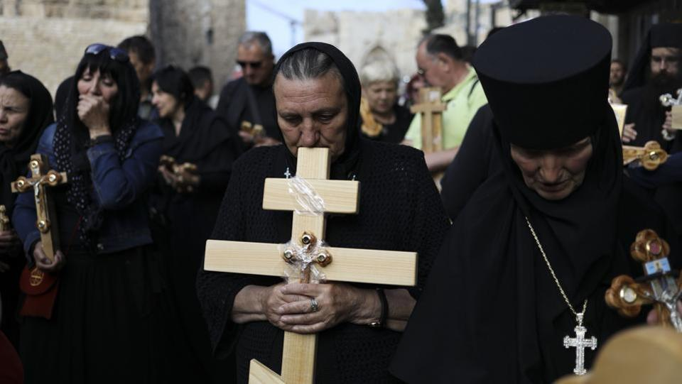 Christian pilgrims attend Good Friday procession in Jerusalem. Good Friday is a Christian holiday which marks the crucifixion of Jesus Christ and his death.   (Dan Baliltyl/AP)