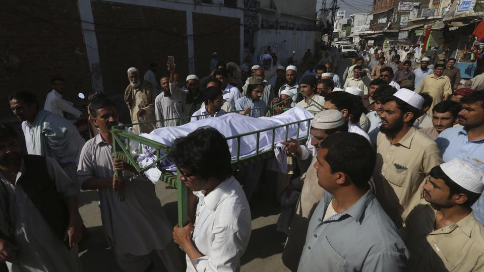 Villagers carry a body of the student for burial in Swabi, Pakistan on Friday.