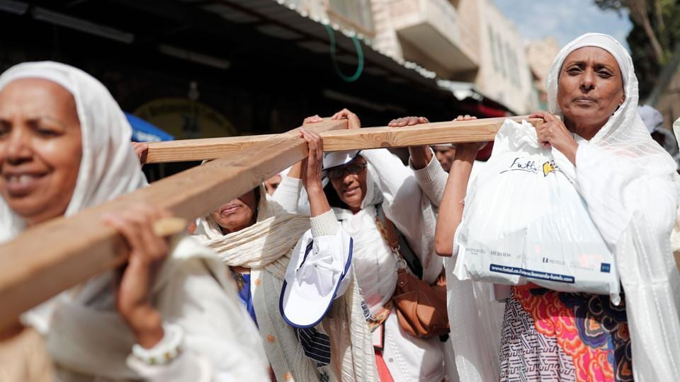Christian pilgrims carry a wooden cross along the Via Dolorosa (Way of Suffering) in Jerusalem's Old City during the Good Friday procession. For Christians, it is the most sorrowful, sombre and sacred day of the year. It is also referred as Holy Friday, Great Friday, Black Friday, or Easter Friday. (Thomas Coex/AFP)