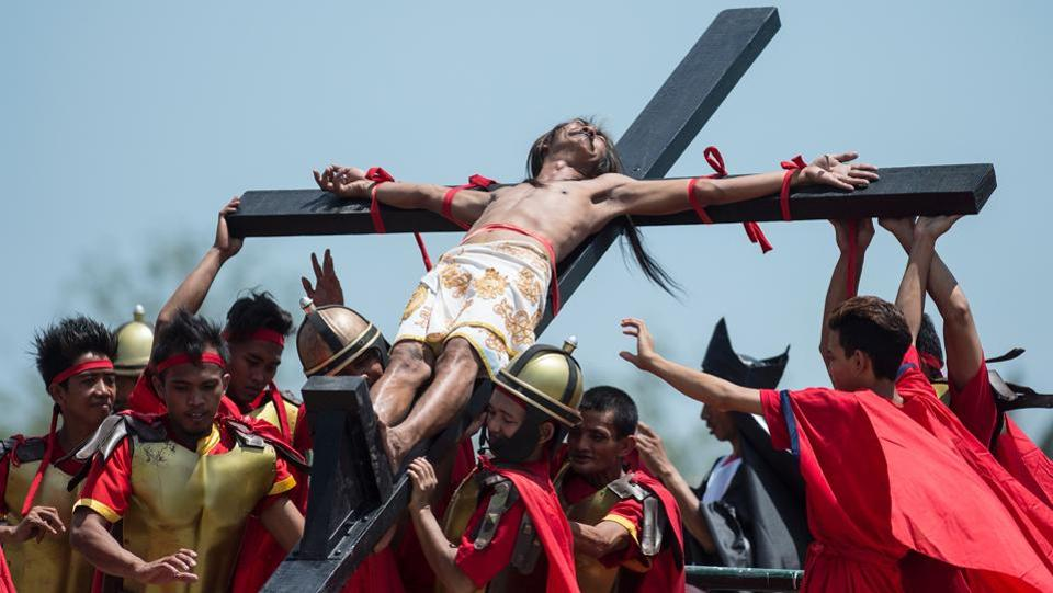 A Philippine Christian devotee reacts in pain while nailed to a cross during a re-enactment of the Crucifixion of Christ. While some say 'good' means holy, others say that it is a modification of 'God Friday.' (Noel Celis/AFP)
