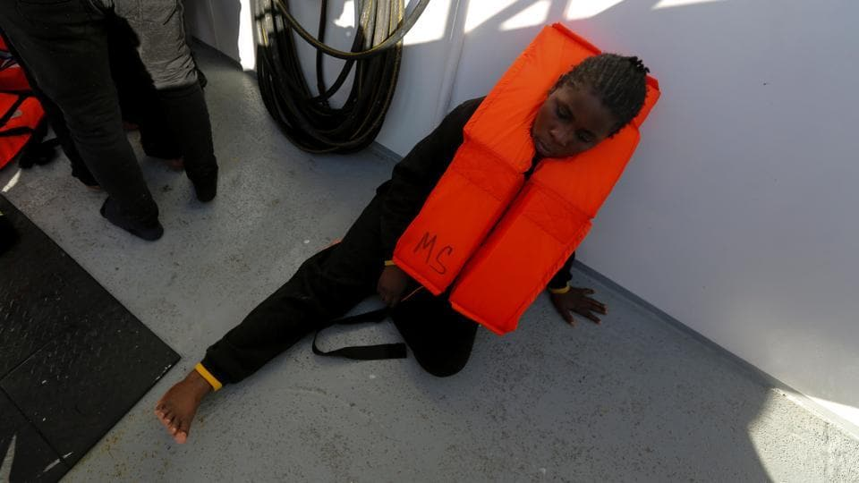 A migrant lies on the deck of the Malta-based NGO Migrant Offshore Aid Station (MOAS) ship Phoenix after being rescued. (Darrin Zammit Lupi / Reuters)