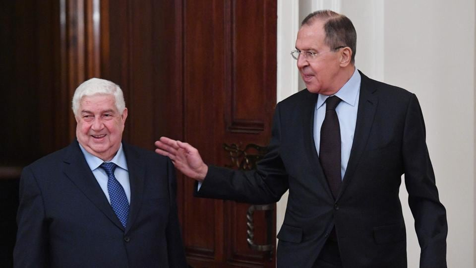 Russian foreign minister Sergei Lavrov (R) welcomes his Syrian counterpart Walid Muallem during their meeting in Moscow on Thursday.