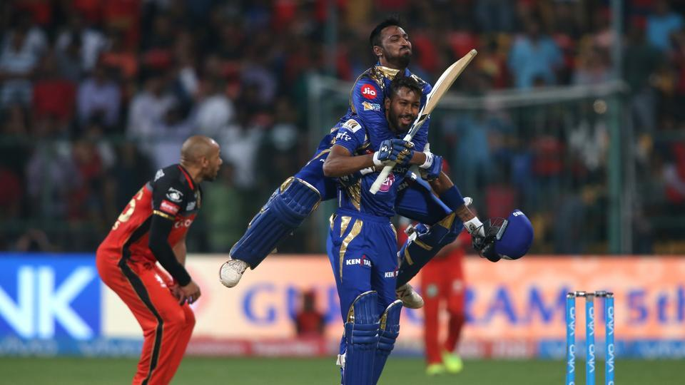 Krunal Pandya jumps on Hardik Pandya after Mumbai Indians beat Royal Challengers Bangalore by four wickets in Bangalore on Friday.  (BCCI)